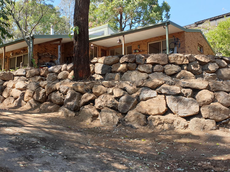 slope retaining wall bush rocks gold coast